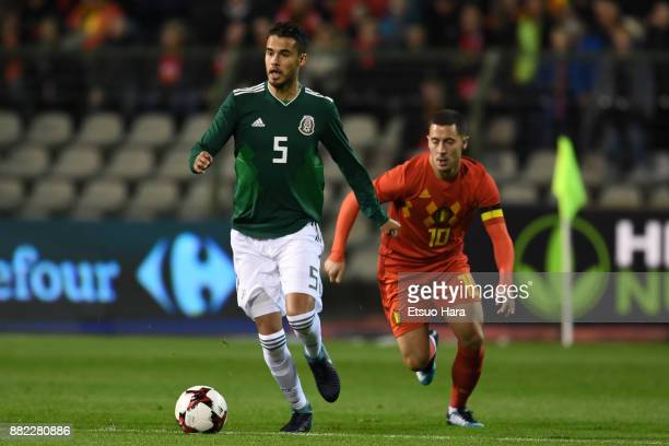 Diego Reyes of Mexico and Eden Hazard of Belgium compete for the ball during the international friendly match between Belgium and Mexico at King...