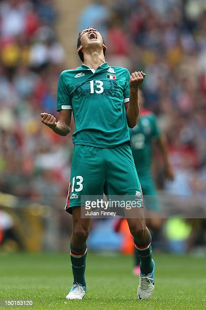 Diego Reyes of Mexico celebrates winning the goal medal after victory in the Men's Football Final between Brazil and Mexico on Day 15 of the London...