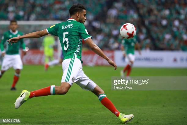 Diego Reyes of Mexico drives the ball during the match between Mexico and The United States as part of the FIFA 2018 World Cup Qualifiers at Azteca...
