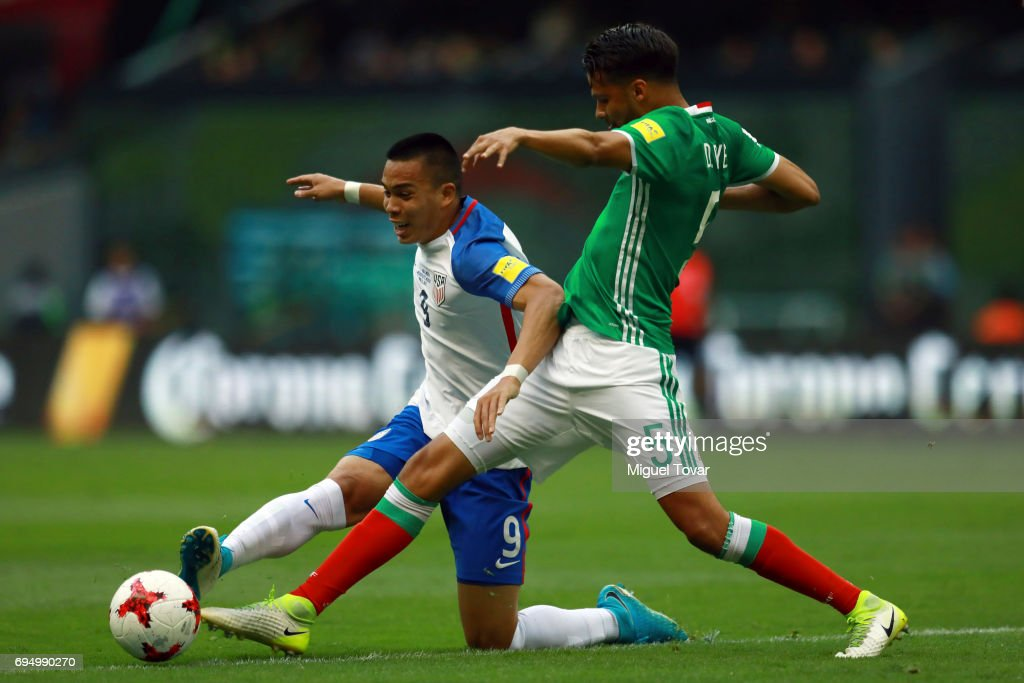 Diego Reyes of Mexico fights for the ball with Bobby Wood of US during the match between Mexico and The United States as part of the FIFA 2018 World Cup Qualifiers at Azteca Stadium on June 11, 2017 in Mexico City, Mexico.