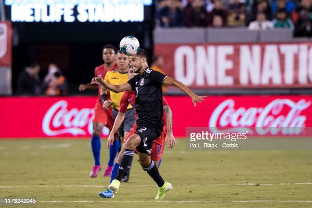 Diego Reyes of Mexico goes up for the header with the METLIFE STADIUM sign behind him during the 1st half of the Friendly match between the United...