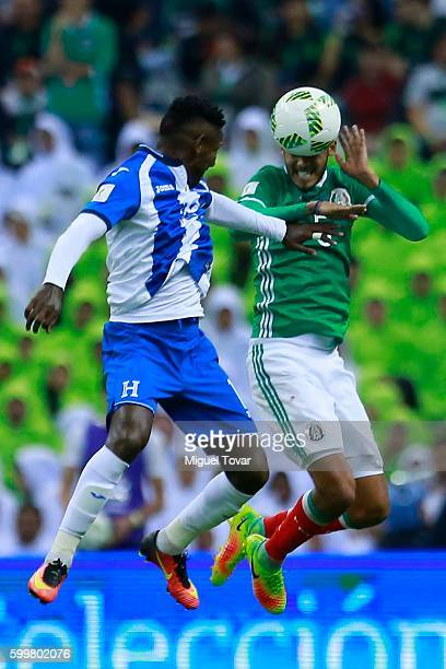 Diego Reyes of Mexico jumps for the ball with Alberth Elis of Honduras during a match between Mexico and Honduras as part of FIFA 2018 World Cup...
