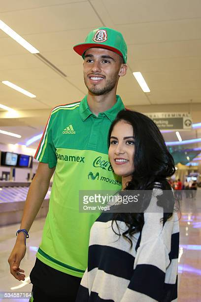 Diego Reyes of Mexico poses with a fan during the Mexico National Team arrival to United States at HartsfieldJackson International Airport on May 26...