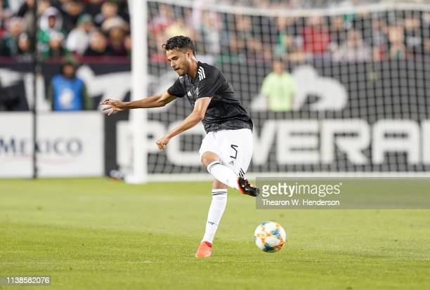Diego Reyes of the Mexico National team passes the ball against Paraguay during the first half of their soccer game at Levi's Stadium on March 26...