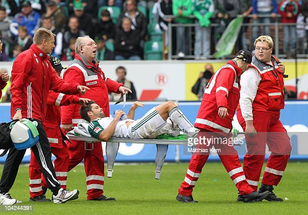 Diego Ribas da Cunha is injured during the Bundesliga match between VFL Wolfsburg and Hannover 96 at Volkswagen Arena on September 18 2010 in...