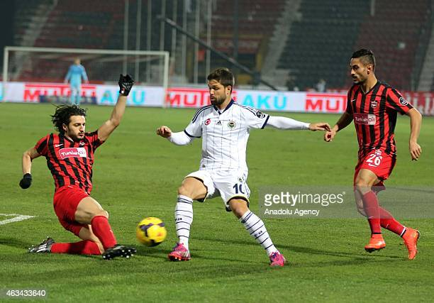 Diego Ribas Da Cunha of Fenerbahce vies with Baris Yardimci of Gaziantepspor during Turkish Spor Toto Super League football match between...