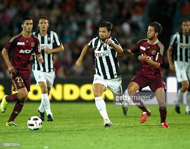 Diego Ribas da Cunha of Juventus FC battles for the ball with Miralem Pjanic of Olimpic Lyon during the pre season friendly match between Juventus FC...