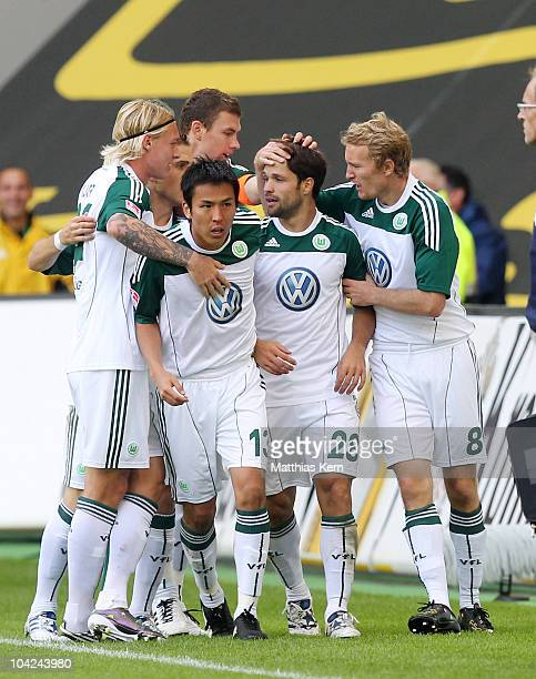 Diego Ribas da Cunha of Wolfsburg jubilates with team mates after scoring the first goal during the Bundesliga match between VFL Wolfsburg and...