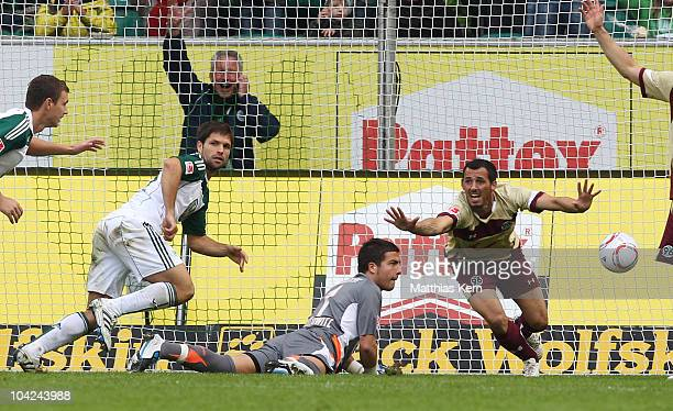 Diego Ribas da Cunha of Wolfsburg scores the first goal during the Bundesliga match between VFL Wolfsburg and Hannover 96 at Volkswagen Arena on...