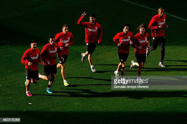 Diego Ribas of Atletico de Madrid does the victory sign as he excersises with teammates during the training session held the Media Day prior to UEFA...
