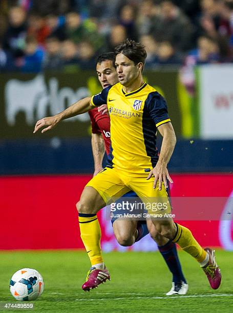 Diego Ribas of Atletico de Madrid duels for the ball with Emiliano Armenteros of CA Osasuna during the La Liga match between CA Osasuna and Atletico...