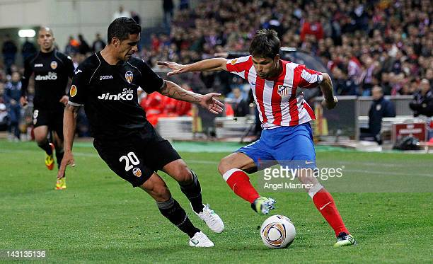 Diego Ribas of Atletico Madrid duels for the ball with Ricardo Costa of Valencia during the UEFA Europa League Semi Final first leg match between...