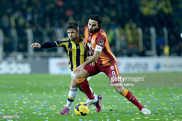 Diego Ribas of Fenerbahce and Selcuk nan of Galatasaray in action during the Turkish Spor Toto Super League derby game between Fenerbahce and...
