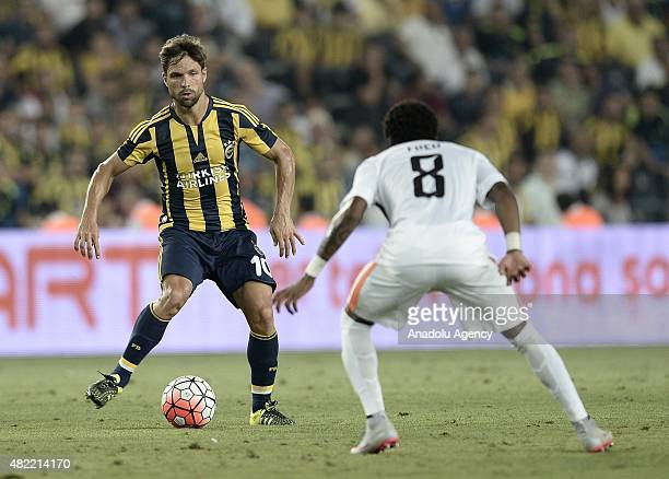 Diego Ribas of Fenerbahce vies with Fred of Shakhtar Donetsk during UEFA Champions League Third Qualifying Round 1st Leg match between Fenerbahce and...