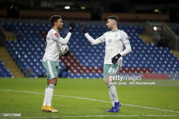 Diego Rico congratulates team-mate Junior Stanislas of Bournemouth after he scores to make it 2-0 from the spot during The Emirates FA Cup Fifth...