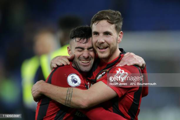 Diego Rico hugs winning goal scorer Dan Gosling of Bournemouth after their sides 10 win during the Premier League match between Chelsea FC and AFC...