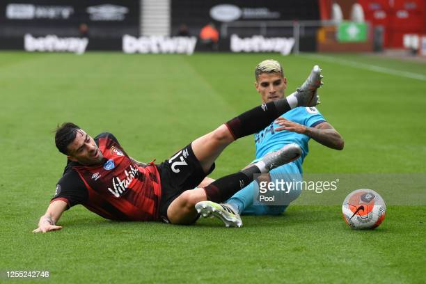 Diego Rico of AFC Bournemouth is challenged by Erik Lamela of Tottenham Hotspur during the Premier League match between AFC Bournemouth and Tottenham...