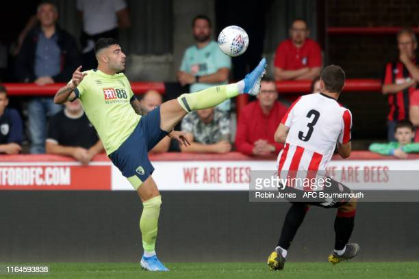 Diego Rico of Bournemouth and Henrik Dalsgaard of Brentford FC during the Pre-Season Friendly match between Brentford and AFC Bournemouth at Griffin...