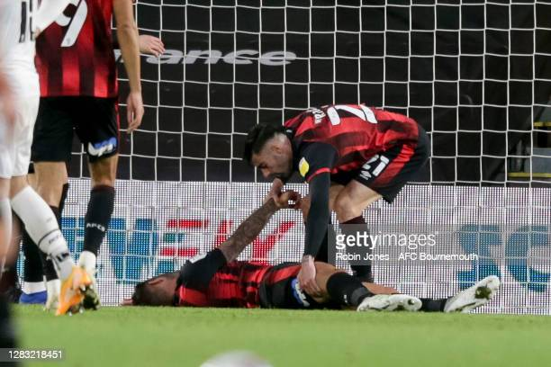 Diego Rico of Bournemouth rushes to the aid of team-mate Steve Cook after his goal-line clearance during the Sky Bet Championship match between AFC...