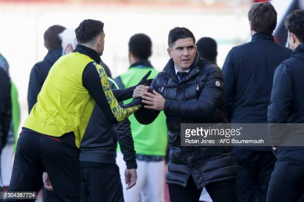 Diego Rico of Bournemouth with Xisco Munoz, Manager of Watford after Bournemouth's 1-0 win during the Sky Bet Championship match between AFC...