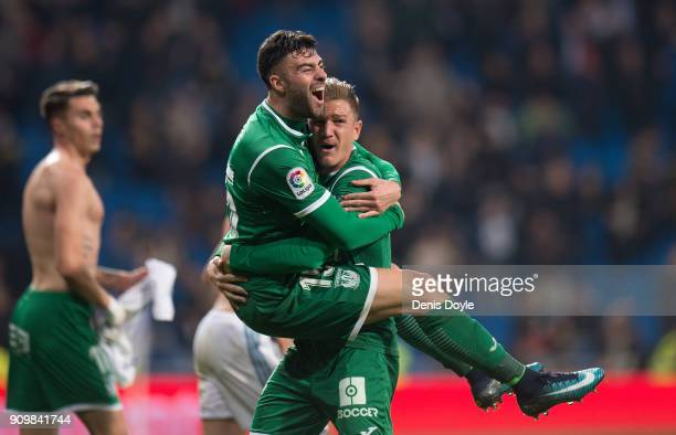 Diego Rico of CD Leganes celebrates with Raul Garcia after they beat Real Madrid 21 on aggregate in the Copa del Rey Quarter Final Second Leg match...