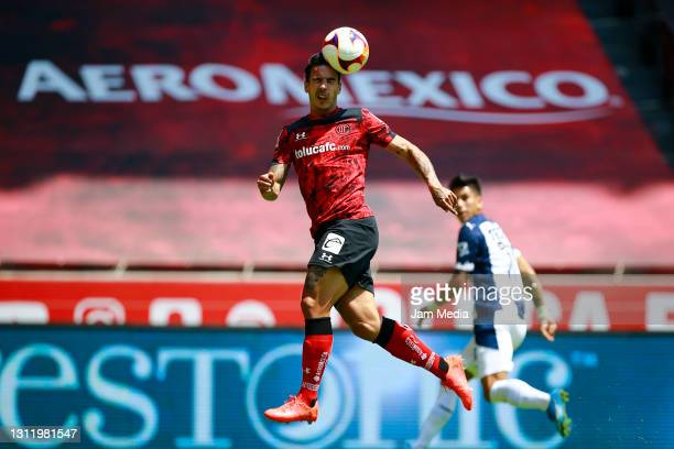 Diego Rigonato of Toluca goes for a header during the 14th round match between Toluca and Monterrey as part of the Torneo Guard1anes 2021 Liga MX at...