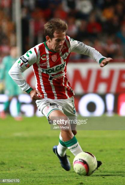 Diego Riolfo of Necaxa drives the ball during the 17nd round match between Necaxa and Morelia as part of the Torneo Apertura 2017 Liga MX at Victoria...