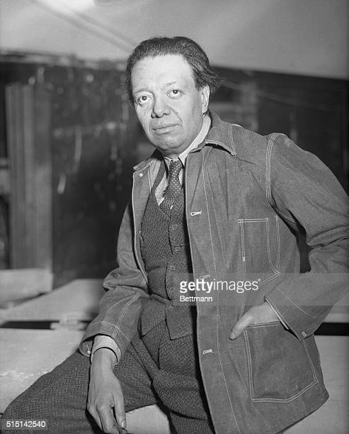 Diego Rivera famous Mexican Artist seen at work on the mural decorations of frescoes he is painting in the Great Hall of the 70story RCA Building in...