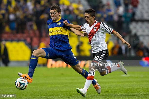 Diego Rivero of Boca fights for the ball with Manuel Lanzini of River during a friendly match between Boca Juniors and River Plate at Azteca Stadium...