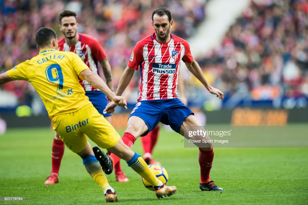 Diego Roberto Godin Leal (R) of Atletico de Madrid battles for the ball with Jonathan Calleri of UD Las Palmas during the La Liga 2017-18 match between Atletico de Madrid and UD Las Palmas at Wanda Metropolitano on January 28 2018 in Madrid, Spain.