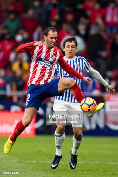 Diego Roberto Godin Leal of Atletico de Madrid fights for the ball with Mikel Oyarzabal of Real Sociedad during the La Liga 201718 match between...