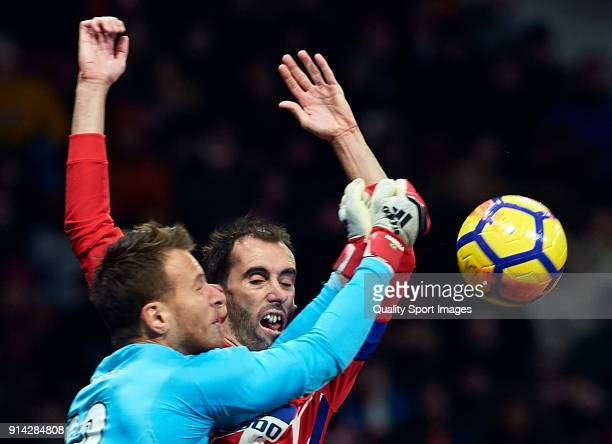 Diego Roberto Godin of Atletico de Madrid collides with Norberto Murara Neto of Valencia during the La Liga match between Atletico Madrid and...