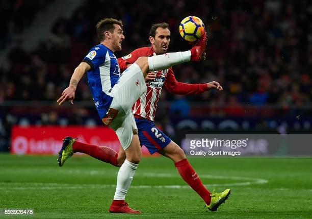 Diego Roberto Godin of Atletico de Madrid competes for the ball with Ibai Gomez of Deportivo Alaves during the La Liga match between Atletico Madrid...