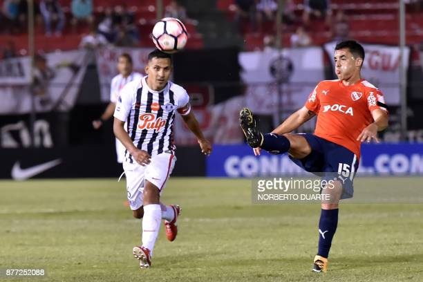 Diego Rodriguez of Argentina's Independiente vies for the ball with Sergio Aquino of Paraguay's Libertad during their Copa Sudamericana first leg...