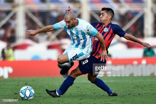 Diego Rodriguez of San Lorenzo challenges Lisandro Lopez of Racing Club during a match between San Lorenzo and Racing Club as part of Superliga...