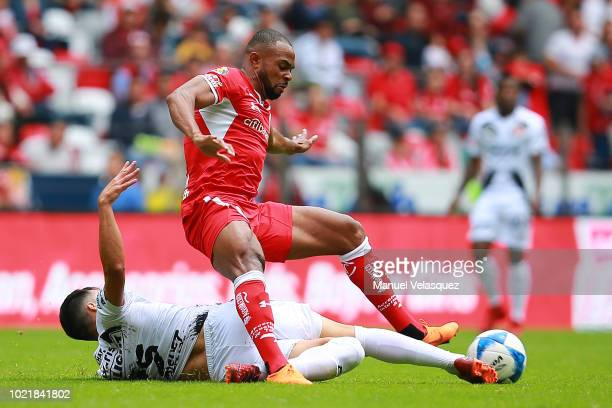 Jose Rivero del Tijuana and Cristian Borja of Toluca fight for the ball during the fifth round match between Toluca and Tijuana as part of the Torneo...