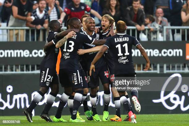 Diego Rolan of Bordeaux celebrates with his teammates after scoring a goal during the Ligue 1 match between Girondins de Bordeaux and Olympique de...