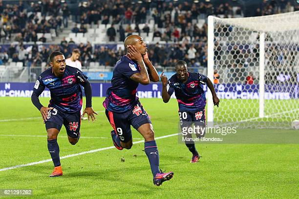 Diego Rolan of Bordeaux celebrates with Malcom and Youssouf Sabaly after scoring a goal during the Ligue 1 match between Girondins de Bordeaux and Fc...