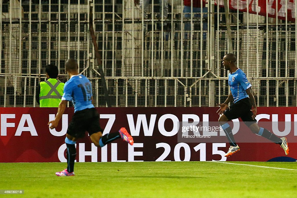 Diego Rolan (R) of Uruguay celebrates after scoring the winning goal during an international friendly match between Chile and Uruguay at Monumental Stadium on November 18 2014 in Santiago, Chile.