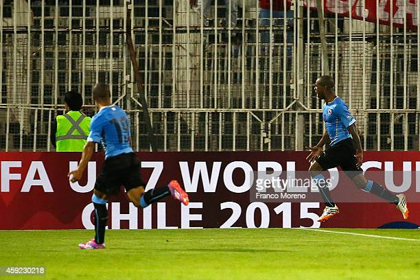 Diego Rolan of Uruguay celebrates after scoring the winning goal during an international friendly match between Chile and Uruguay at Monumental...