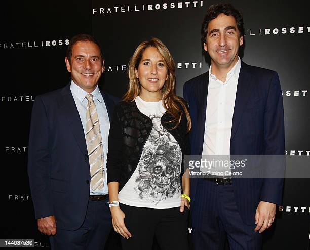 Diego Rossetti Jo Squillo and Luca Rossetti attend the Fratelli Rossetti Cocktail Party on May 8 2012 in Milan Italy