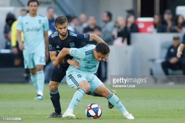 Diego Rossi of Los Angeles FC and Cristian Roldan of Seattle Sounders fight for control of the ball during the second half of a game at Banc of...