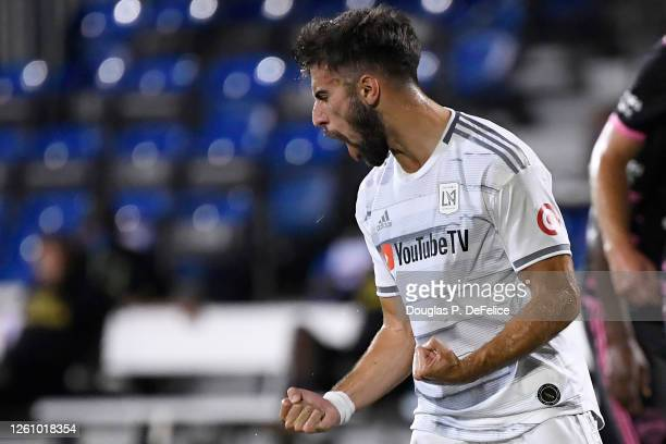 Diego Rossi of Los Angeles FC celebrates after scoring the opening goal of the match from the penalty spot during a round of 16 match of the MLS is...