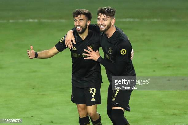 Diego Rossi of Los Angeles FC celebrates his goal with teammate Jordan Harvey of Los Angeles FC during the CONCACAF Champions League final game...