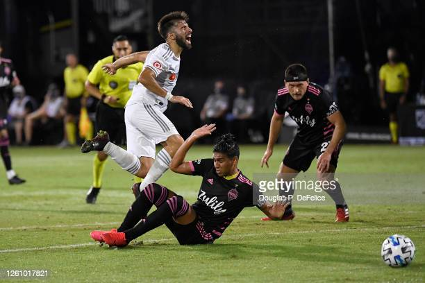 Diego Rossi of Los Angeles FC is fouled and gets a penalty during a round of 16 match of the MLS is Back Tournament between Seattle Sounders and Los...