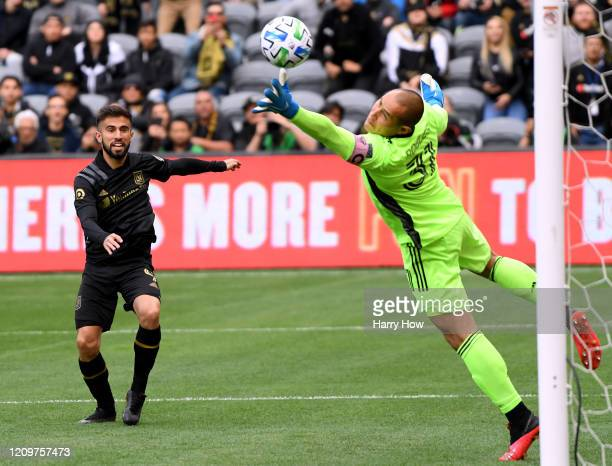 Diego Rossi of Los Angeles FC reacts as Luis Robles of Inter Miami CF makes a a save on his header during the first half at Banc of California...