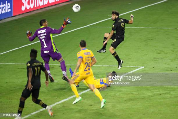 Diego Rossi of Los Angeles FC scores a goal over Nahuel Guzman of Tigres UANL during the CONCACAF Champions League final game at Exploria Stadium on...