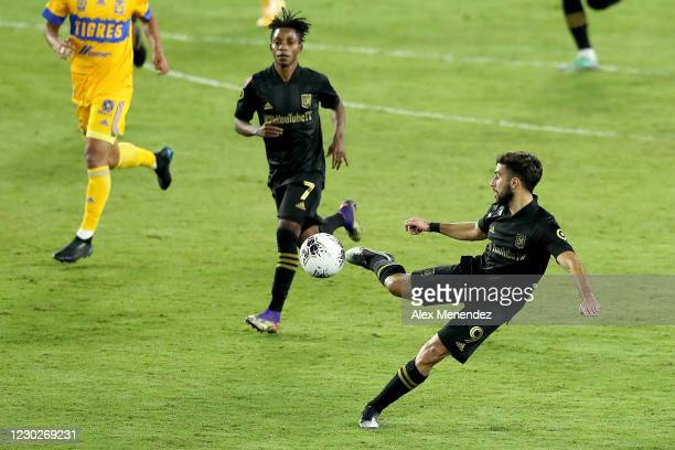 Diego Rossi of Los Angeles FC stops the ball in front of Latif Blessing of Los Angeles FC during the CONCACAF Champions League final game against...