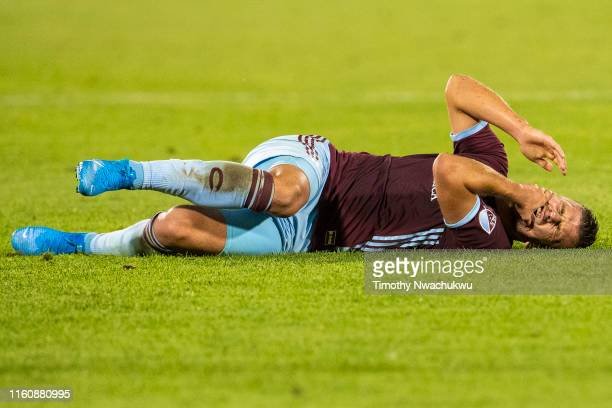 Diego Rubio of the Colorado Rapids clutches his face following a foul against the San Jose Earthquakes during the second half at Dick's Sporting...