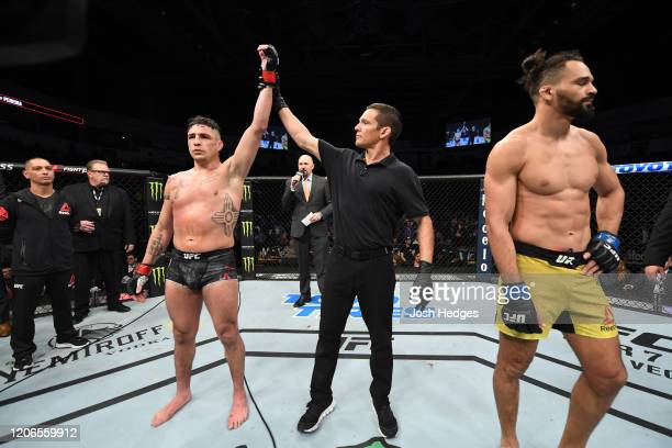 Diego Sanchez is declared the winner after Michel Pereira is disqualified for an illegal knee in their welterweight bout during the UFC Fight Night...